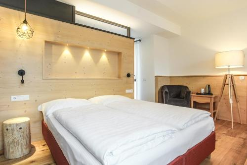 Ein Bett oder Betten in einem Zimmer der Unterkunft Berggasthof Locanda Alpina Dorfner
