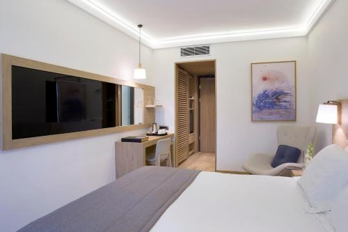 A television and/or entertainment centre at Golden Age Athens Hotel