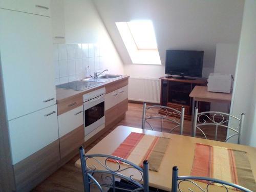A kitchen or kitchenette at Hostel Falkenstein