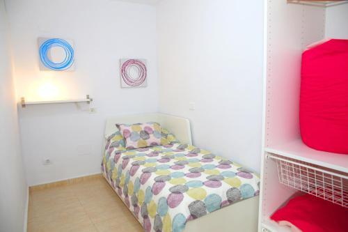 A bed or beds in a room at Vivienda Vacacional Camino del Senderista