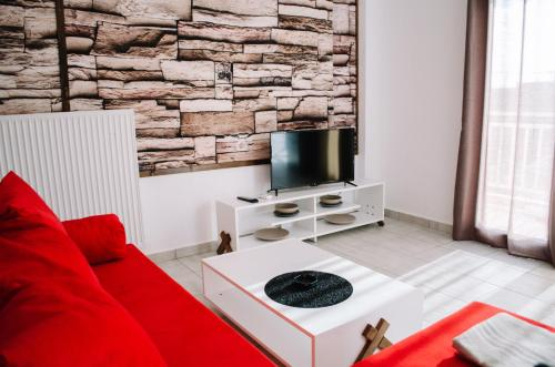 A television and/or entertainment centre at Deja-Vu Apartments