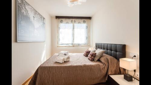 A bed or beds in a room at Apartamento en la Ciudad de las Ciencias y cerca de la playa