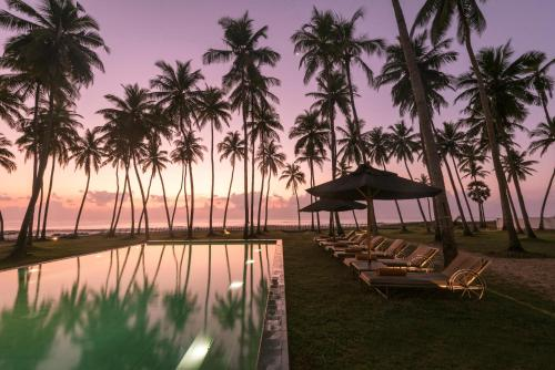 The swimming pool at or near Kottukal Beach House by Jetwing
