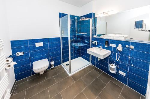 A bathroom at Best Western Plus Royal Suites