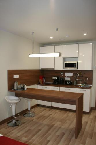 Кухня или мини-кухня в Апартаменты Salt City Moscow