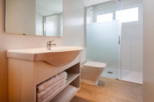 Ett badrum på Apartamentos Sol y Vera