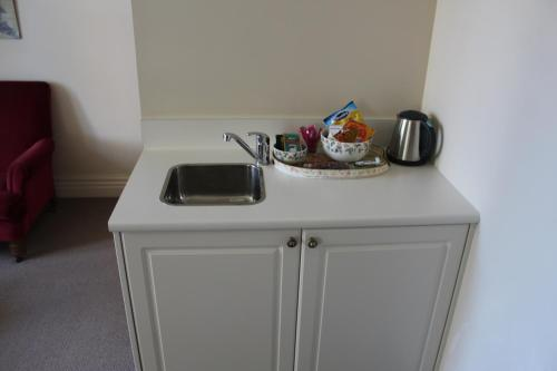 A kitchen or kitchenette at The Grange B&B