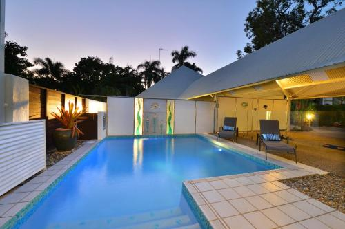 The swimming pool at or near Serenity Port Douglas