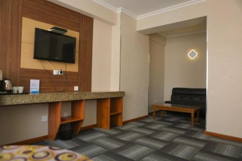 A television and/or entertainment center at Zolo Hotel