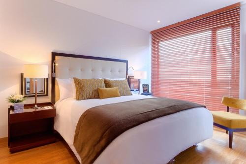 A bed or beds in a room at 93 Luxury Suites & Residences