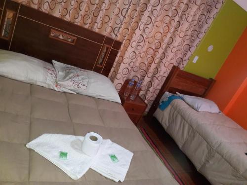 A bed or beds in a room at JOYA SUIT TITIKAKA