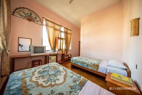 Cama o camas de una habitación en Gypsy Inn