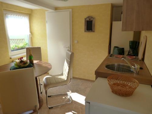 Küche/Küchenzeile in der Unterkunft Ferienhaus Scheper