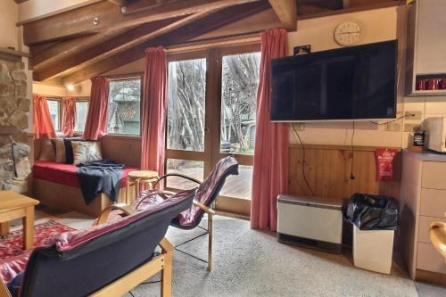 A television and/or entertainment center at Bindi - Alpine Getaways's Chalet at Tower Rd