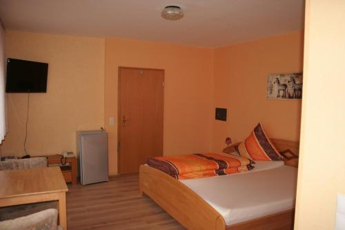A bed or beds in a room at Hotel Michaela