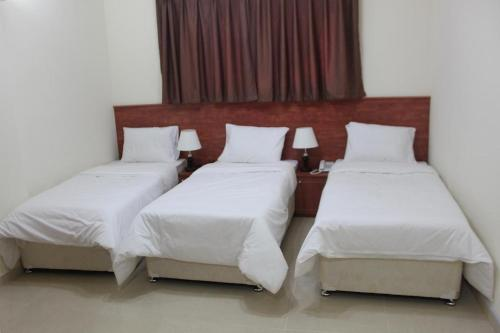 A bed or beds in a room at Africana Hotel