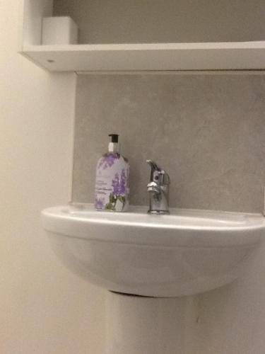 A bathroom at Regent Serviced Suites