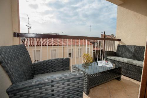 A balcony or terrace at RENTY Côté Parc Parking inclus
