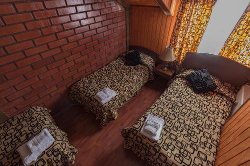Cama ou camas em um quarto em Cabañas Última Esperanza