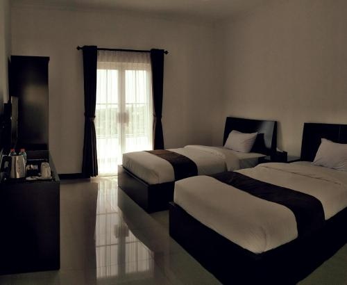 A bed or beds in a room at Amaranta Guest House