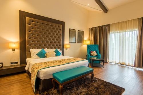 A bed or beds in a room at Riva Beach Resort