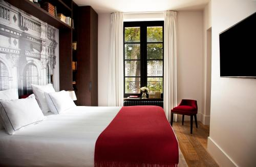 A bed or beds in a room at Relais de Chambord - Small Luxury Hotels of the World