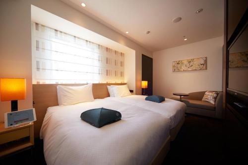 Tempat tidur dalam kamar di Hotel Forza Nagasaki
