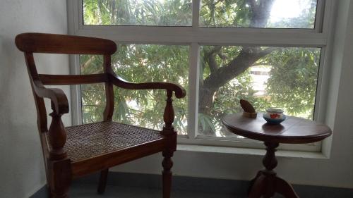 A seating area at Adams Wood House Ayurveda Homestay Kochi