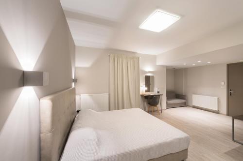 Ένα ή περισσότερα κρεβάτια σε δωμάτιο στο Castello Hotel