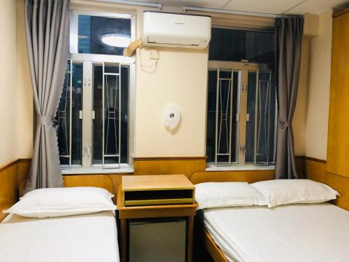A bed or beds in a room at Good Fortune Inn
