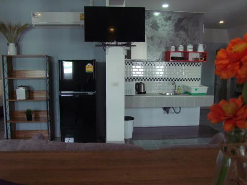 A television and/or entertainment center at Samui Green Hotel