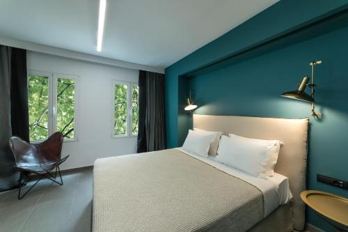 A bed or beds in a room at Sir Athens