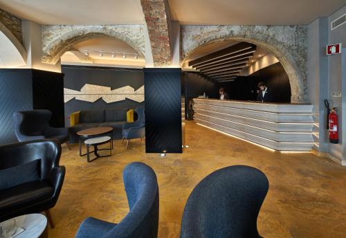El salón o zona de bar de My Story Hotel Tejo