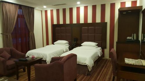 Cama ou camas em um quarto em Elaf Suites Al-Andalus