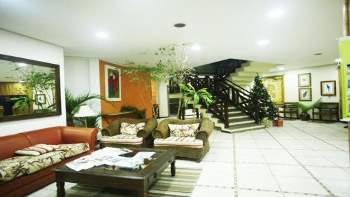 O saguão ou recepção de Ilha Flat Hotel-Apartamento Schiavetti-Ilhabela