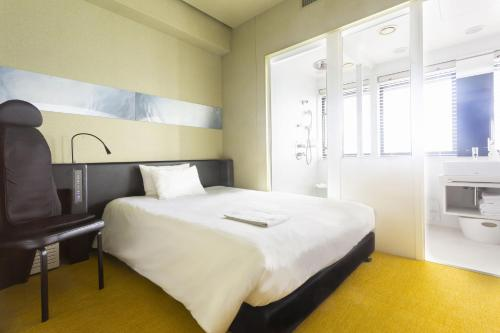 A bed or beds in a room at remm Shin-Osaka