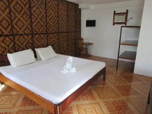 A bed or beds in a room at Point 303 Resort