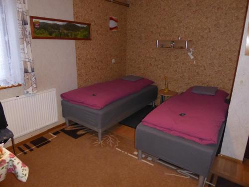 A bed or beds in a room at Ferienzimmer