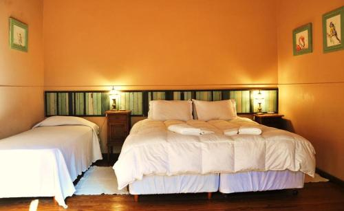 A bed or beds in a room at Antigua Casona Bed & Breakfast