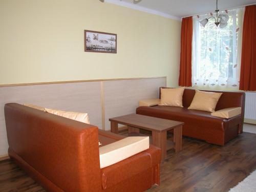 A seating area at Lábas-Ház Apartmanok 2