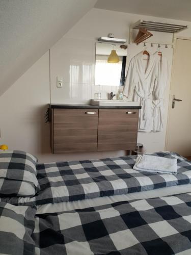 Een bed of bedden in een kamer bij Bed and Breakfast Den Bosch