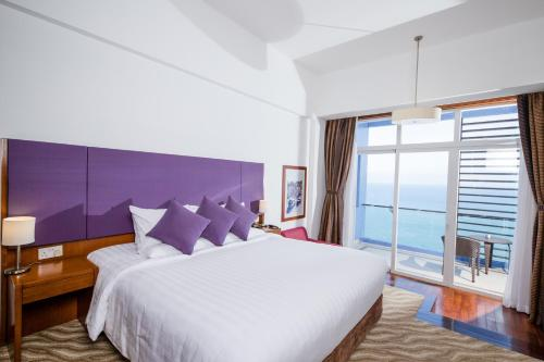 Un ou plusieurs lits dans un hébergement de l'établissement Hotel Novotel Nha Trang