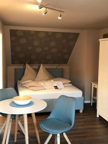 Ein Bett oder Betten in einem Zimmer der Unterkunft Altstadtpension am Dom