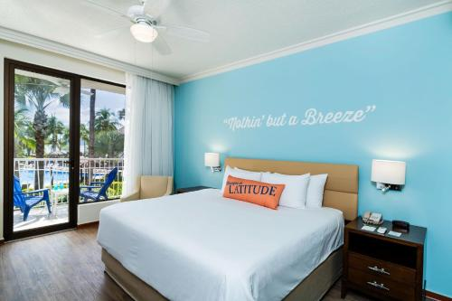 A bed or beds in a room at Margaritaville Beach Resort Playa Flamingo