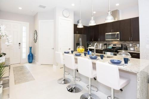 A kitchen or kitchenette at Dream Themed Vacation Townhome with private hot tub SU2602