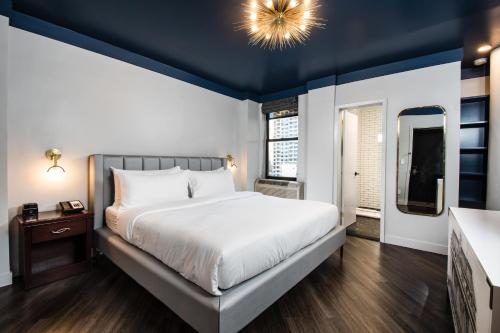 A bed or beds in a room at The Hotel at New York City