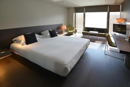 A bed or beds in a room at Hotel Soho