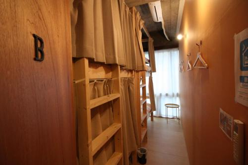 A bunk bed or bunk beds in a room at Tomarotto Hostel
