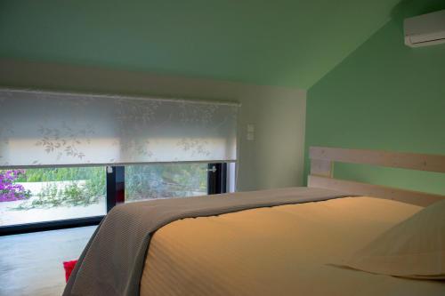 Кровать или кровати в номере Alissachni