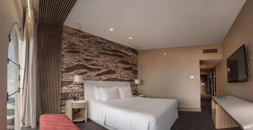 A bed or beds in a room at Doubletree By Hilton Iquitos
